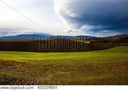 Picturesque and legendary Tuscany. Storm begins over Tuscany hills. Beautiful Italy. The concept of active, rural and photo tourism