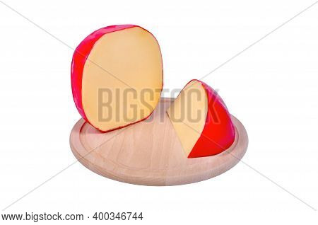 Very Tasty Edam Cheese Wrapped In Red Paraffin Wax, On Cutting Board, Isolated White Background