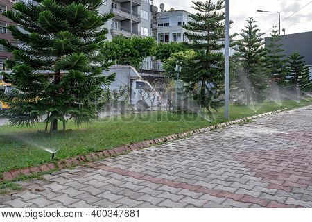 Alanya, Turkey - October 22, 2020: Lawn Irrigation In A Park Area On The Promenade In Alanya. Water