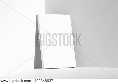 Blank White Empty Rectangular Poster On Floor Leaning At Empty White Walls In Cornet Diagonal View,