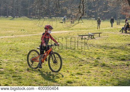 Prague, Czech Republic. 03-11-2020. Kid Riding On Bike In Park Stromovka. Covid-19 It Is A World Spr