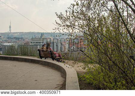 Prague, Czech Republic. 03-11-2020. Couple Enjoying Panoramic View Of Prague Bridges Crossing Vltava