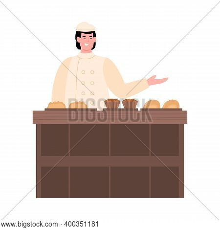 Baker Is Selling Bread And Sweet Pastries In Bakehouse. Man In Uniform Working In Baking Store. Bake