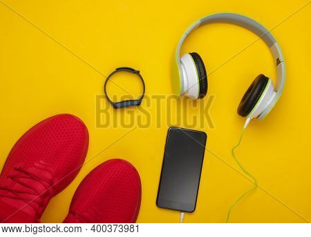 Flat Lay Composition Of Modern Gadgets For Sports And Fitness. Headphones, Smart Bracelet, Smartphon