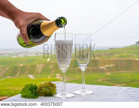 Tasting Of French Sparkling White Wine With Bubbles Champagne On Outdoor Terrace With View On Grand