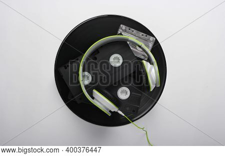 Retro Media. Stereo Headphones, Video Cassettes, Vinyl Records, Audio Cassette On A White Background