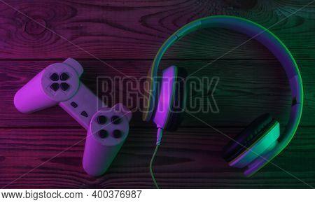 Retro Stereo Headphones With Gamepad. Neon Purple Green Light. Gaming Concept. Gradient Glow. 80s. R