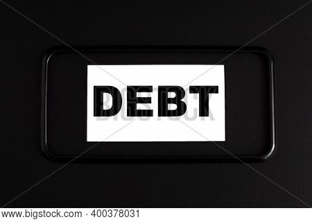 The Word Debt In A Black Frame On A Black Background