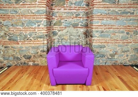 Comfortable And Stylishly Designed Purple Office Chair In Front Of A Wall