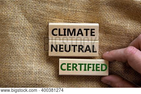 Climate Neutral Certified Symbol. Wooden Blocks With Words 'climate Neutral Certified'. Male Hand. B