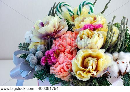 Beautiful Winter Floral Composition With Tulips, Carnations, Cotton Flower, Spruce Branches