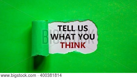 Tell Us What You Think Symbol. Words 'tell Us What You Think' Appearing Behind Torn Green Paper. Bus