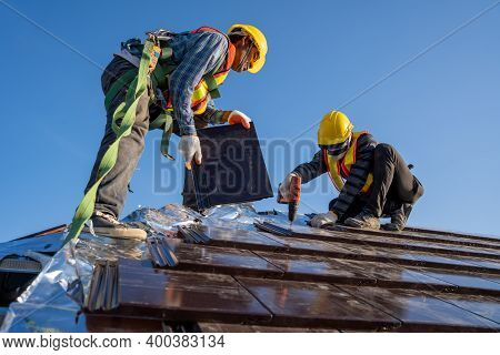 Two Work Construction Worker Install New Ceramic Tile Roof With Roofing Tools Electric Drill Used In