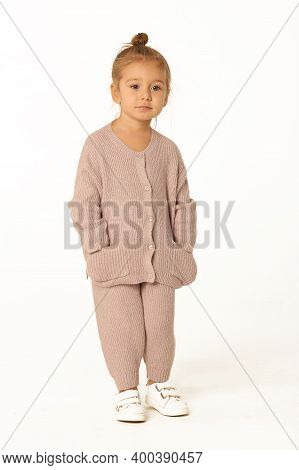 Cute Little Blond Baby Girl In Pink Knitted Pant Suit Smile Full Body Photo