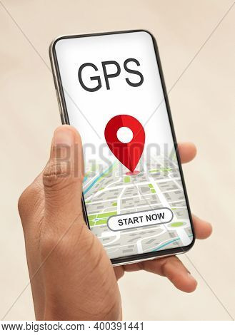 Modern Gps Application. African American Man Using Smartphone With Location Tracking App On Screen,