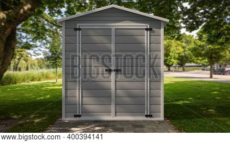 Gardening Tools Storage Shed In The House Backyard On Green Trees Background. 3D Illustration