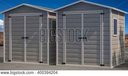 Storage Sheds On Asphalt Road And Blue Sky Background. 3D Illustration