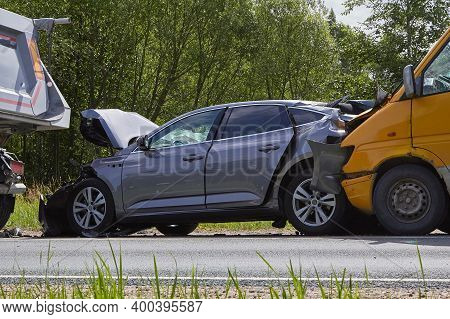 Damaged Cars On The Highway At The Scene Of An Accident