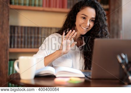 Virtual Video Conference. Portrait Of Smiling Young Woman Making Online Call On Laptop, Waving With