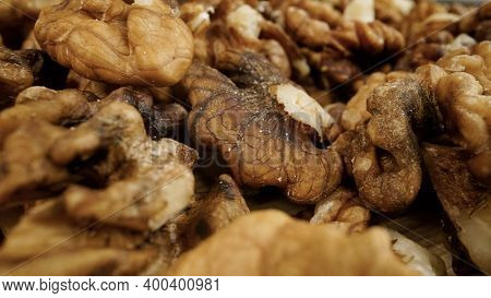 Heap Of Raw Walnuts Close-up As Background. Walnuts Close-up.walnuts As Background.