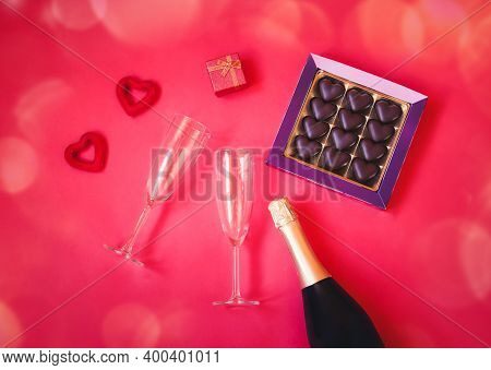 Romantic And Valentine's Day Concept. Two Empty Glasses, Bottle Of Champagne, Box Of Chocolate, Gift