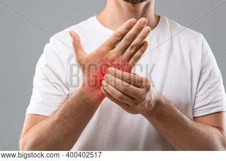 Dermatitis, Eczema, Allergy, Psoriasis Concept. Unrecognizable Man Scratching Itch On His Hand, Grey