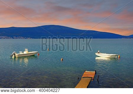 Winter Mediterranean Sunset. Fishing Boats On Water. Montenegro, Adriatic Sea,  Bay Of Kotor Near Ti