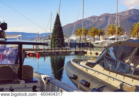 Tivat , Montenegro - December 13 2020:  Christmas Tree In Yacht Marina. View Of Porto Montenegro Mar