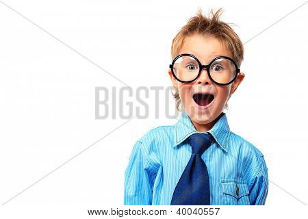 Portrait of a surprised little boy in spectacles and suit. Isolated over white background.