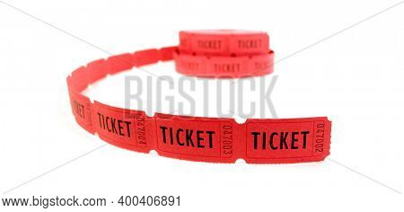 Rolls of red tickets connected together for admission on white backgrouind