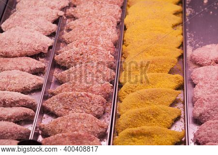 Raw Cutlets And Semi-finished Meat Products In The Culinary Section On The Counter Of A Grocery Stor