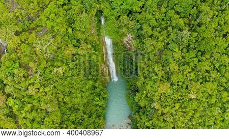 Waterfall In The Rainforest Jungle From Above. Tropical Mantayupan Falls In Mountain Jungle. Philipp