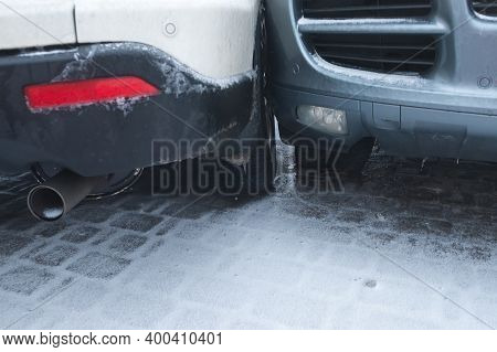 Car Accident Involving Collision Of Two Automobiles On Ice Snow Road. Two Crashed Cars Close Up On A