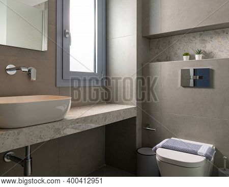 Contemporary Style Interior Of Small Modern Bathroom Tiled Gray Pebble Stone With Window, Vessel Bow