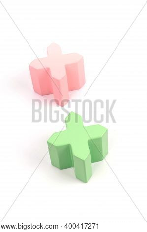 Two Wooden Crosses Of Pink And Green. Toys Made Of Natural Wood. Colorful Pluses Made Of Natural Woo