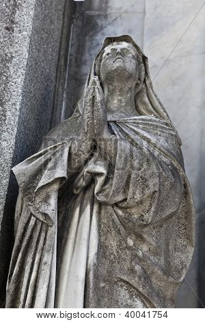 Sculpture Of A Woman Praying At Recoleta Cemetery