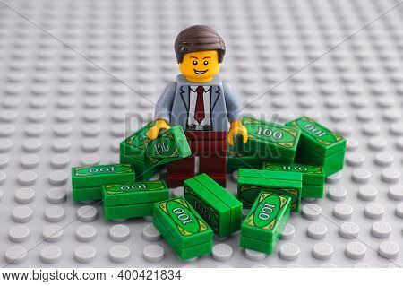 Tambov, Russian Federation - December 19, 2020 Lego Businessman Minifigure Standing In A Pile Of Cas