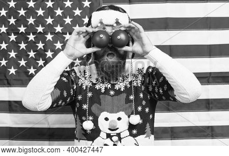 Patriotic Surprise. Surprised Hipster Hold Baubles As Glasses. Bearded Man Look With Surprise. Santa