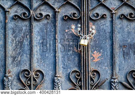 The Old Iron Gates Are Closed With A Padlock. The Passage Is Blocked.