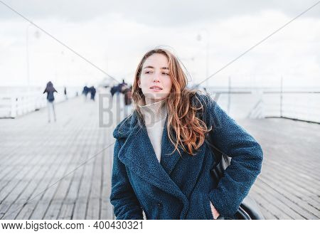 Lonely Carefree Traveler Woman On A Sea Pier. Happy Concept, Free People And Enjoying Life. Female W