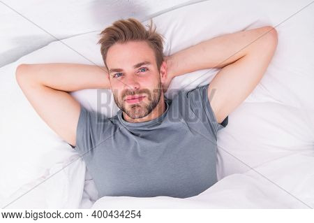 Starting His Day With Regular Routine. Handsome Guy Awaken For Morning Routine. Sexy Man Lying In Be