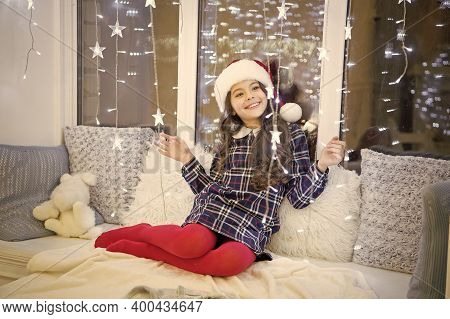 New Year. Santa Claus. Little Girl Child Received Gift. Turn On Garland For Magic Atmosphere. Illumi