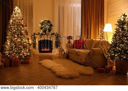 Festive Living Room Interior With Christmas Trees And Fireplace