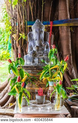 A Statue Of Ganesha In A Thai Temple, A Place Of Worship And Veneration Of The God Of Wisdom And Pro