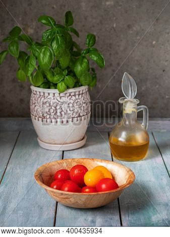 Ripe Tomatoes In A Deep Bowl, Vegetable Oil In A Glass Gravy Boat And Growing Basal