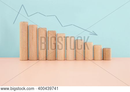 Wood Block Chart Histogram Or Infographics Bar Chart With Arrow Down In Blue Background, Financial C