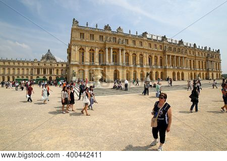 Versailles, France - June 08, 2013: People On A Guided Tour In The Grounds Of The Palace Of Versaill
