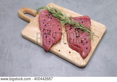 Raw Meat Rib Eye Steak. Cooking Beef Steak Fillets. Slices Of Medium Rare Roast Beef Meat On Wooden