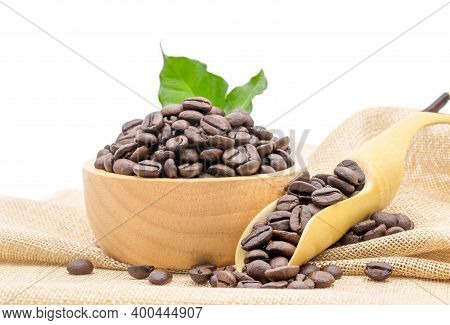 Coffee Beans Roasted In A Wooden Bowl And Beans Scoop On Sackcloth Isolated Over White Background.