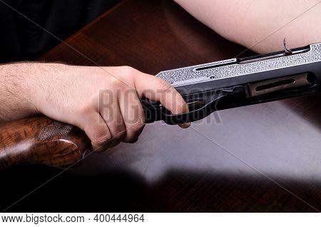 Shotgun Trigger Mechanism Isolated On Wood Background, Hunting Shotgun Detail
